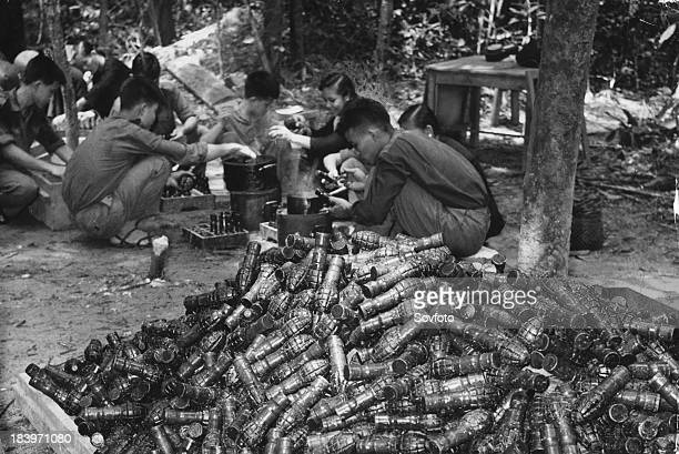 Communist guerrillas make grenades for National Liberation Army troops fighting the US South Vietnam Vietnam War 1965