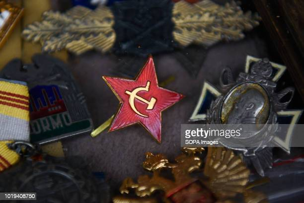 A communist lapel pin is seen at the weekly flea market in Kazimierz Krakow's former Jewish district Kazimierz is a district the south it was the...