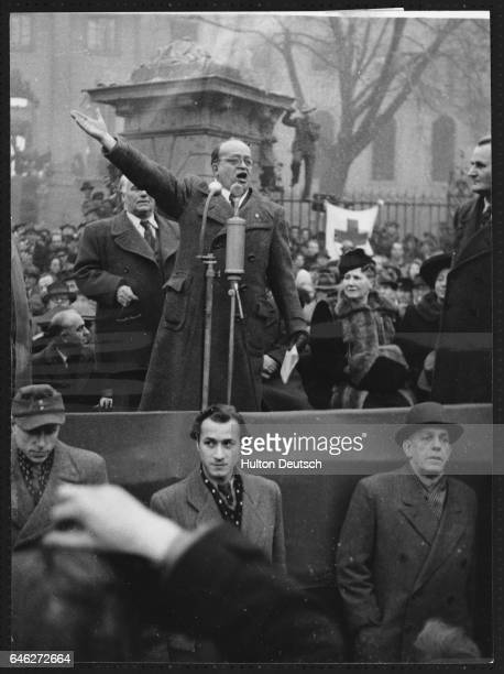 Communist leader Fritz Ebert addresses a crowd after his election surrounded by fellow prominent Communists Standing below the podium are their...