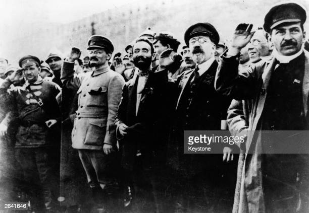 Communist leaders including Joseph Stalin and Leon Trotsky seen saluting in the street during the Russian Revolution.