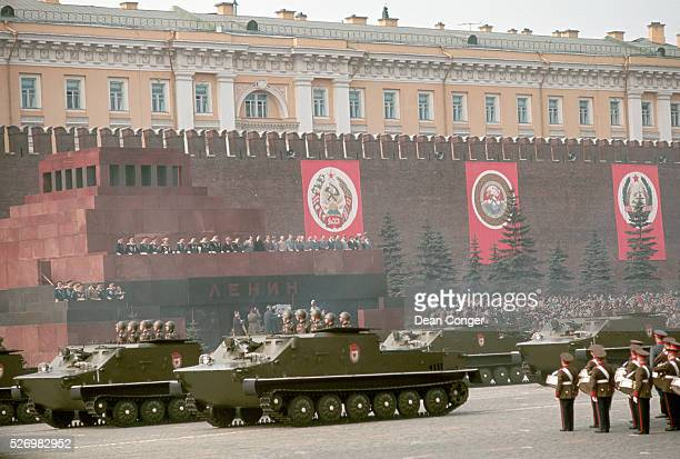 Communist leaders review a convoy of tanks as they pass in front of the Lenin Mausoleum outside the Kremlin during the annual May Day parade