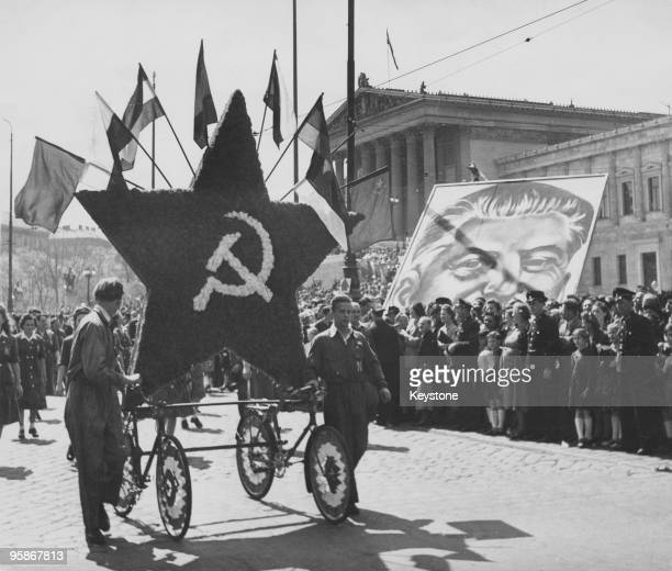 A communist May Day parade outside the parliament buildings Vienna 1st May 1950 On the right is a large portrait of Soviet leader Joseph Stalin