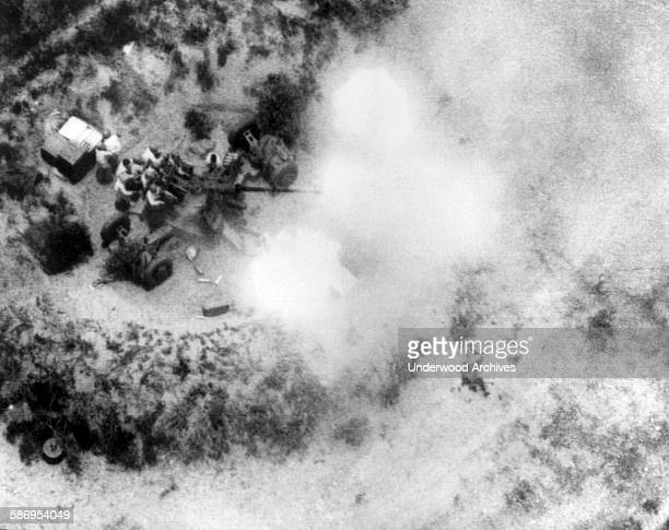 Communist North Vietnamese gunners blaze away with a 57mm antiaircraft gun at US Air Force planes attacking a river crossing Thanh Hoa Viet Nam...