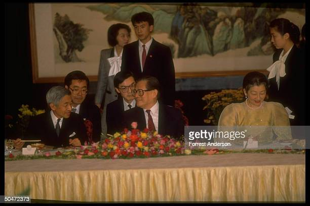 Communist Party chief Jiang Zemin hosting Japanese Emperor & Empress, Akihito & Michiko, at state banquet, w. Pair of hovering interpreters.
