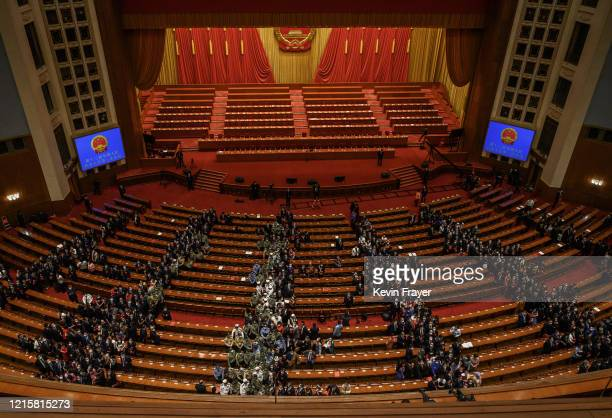 Communist Party delegates file out of the closing session of the National People's Congress which included a vote on a new draft security bill for...