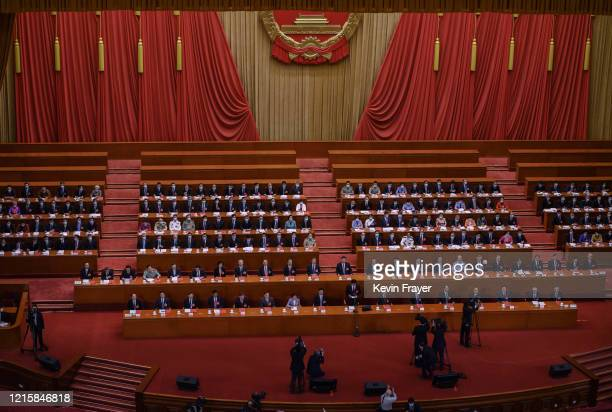Communist Party delegates, including president Xi Jinping, center, take part in a session before voting on a new draft security bill for Hong Kong...