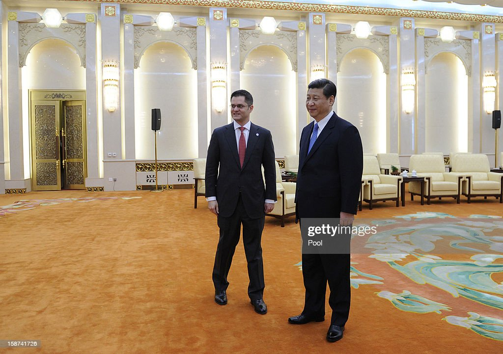 Communist Party leader Xi Jinping (R) prepares to shake hands with Vuk Jeremic (L), president of the 67th Session of the UN General Assembly, at the Great Hall of the People on December 27, 2012 in Beijing, China. UN General Assembly President Vuk Jeremic is visiting China through December 28.