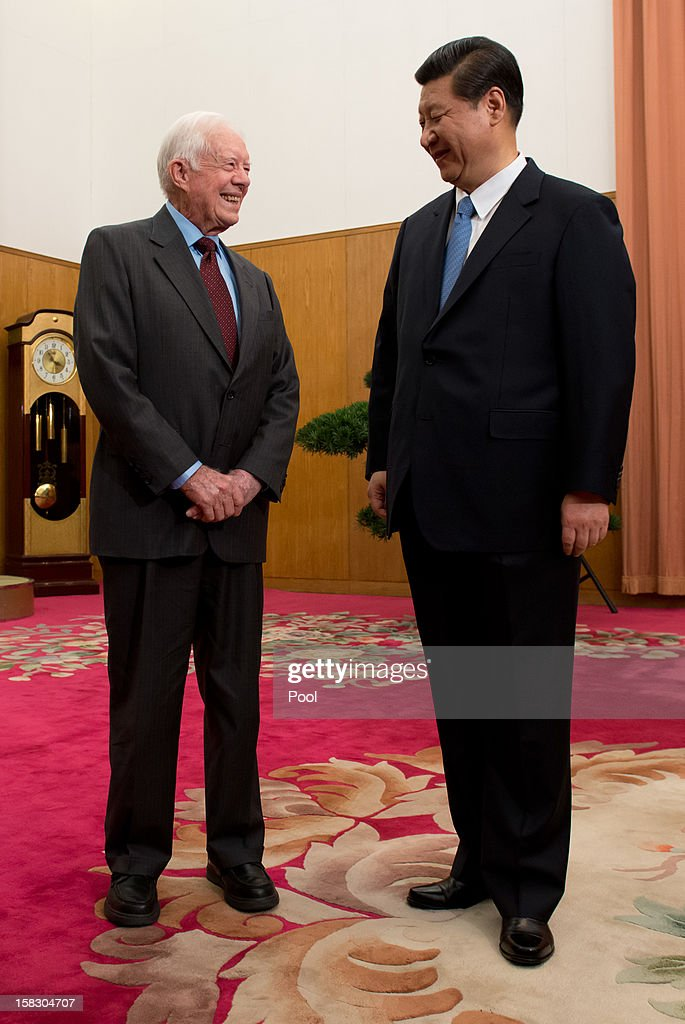 Communist Party leader Xi Jinping (R) shakes hands with former US President Jimmy Carter (L) in room 202 of the Zhongnanhai leadership compound on December 13, 2012 in Beijing, China. Carter congratulated Xi on his new position before the pair sat down for talks.