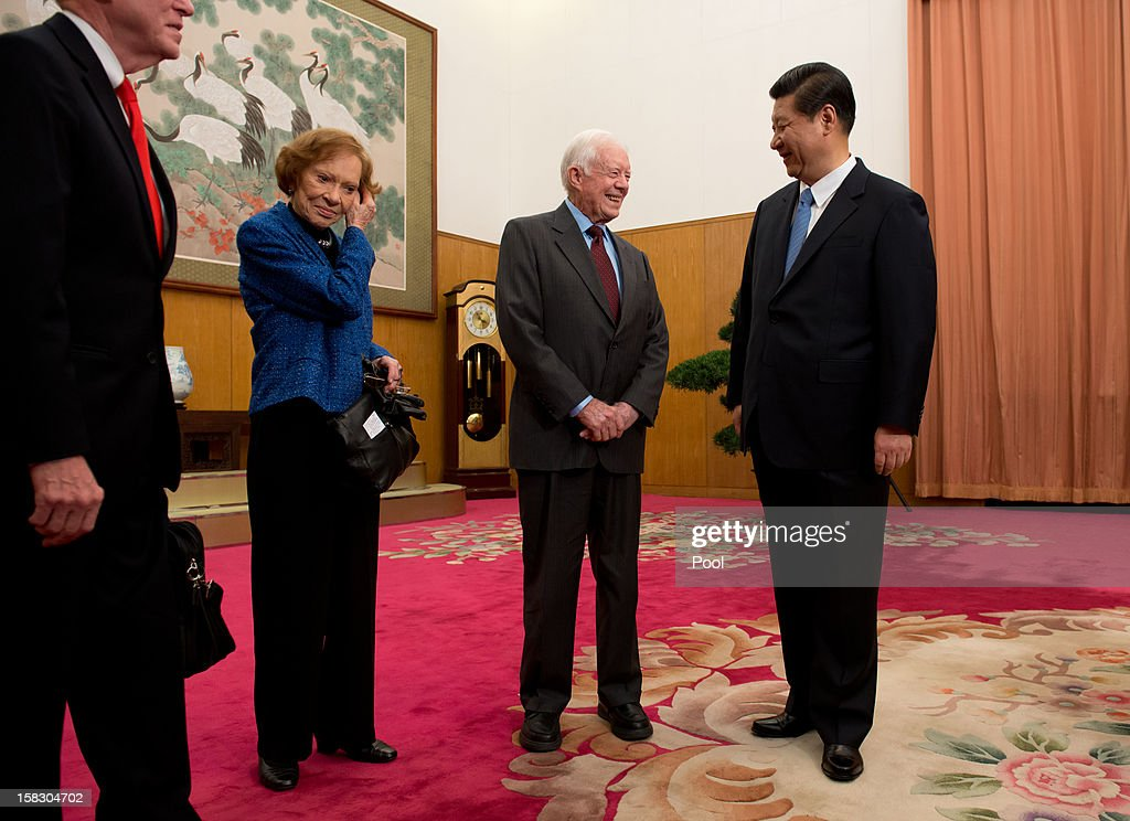 Communist Party leader Xi Jinping (R) talks with former US President Jimmy Carter (2nd-R) as his wife Rosilyn looks on in room 202 of the Zhongnanhai leadership compound on December 13, 2012 in Beijing, China. Carter congratulated Xi on his new position before the pair sat down for talks.