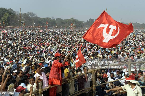 A Communist Party of India supporter waves a party flag while attending a mass rally in Kolkata on February 7 2010 Thousands of left party supporters...