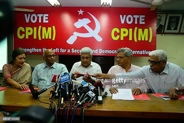 Communist Party of IndiaMarxist or CPM general secretary Prakash Karat and party leader Sitaram Yechury with party members Brinda Karat S Ramachandra...