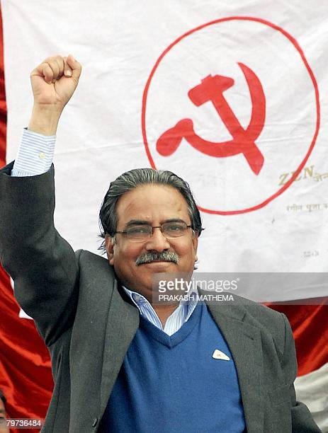 Communist Party of Nepal chairman Prachanda waves to the crowd during a mass meeting organised by the party to mark the 13th anniversary of the start...