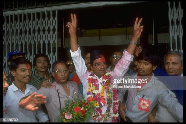 Communist Party of Nepal General Secretary Madan Bhandari veeing fingers celebrating CPN UML gains in parliamentary elections