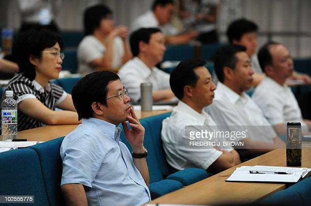 Communist party officials from acoss the country attend a lecture at the Central Party School of the Communist Party in Beijing on June 30 2010 Also...