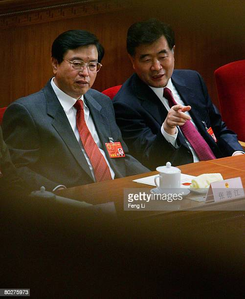 Communist party secretary of Guangdong Wang Yang talks with his predecessor Zhang dejiang who is newly elected as China's new Vice Premier during the...