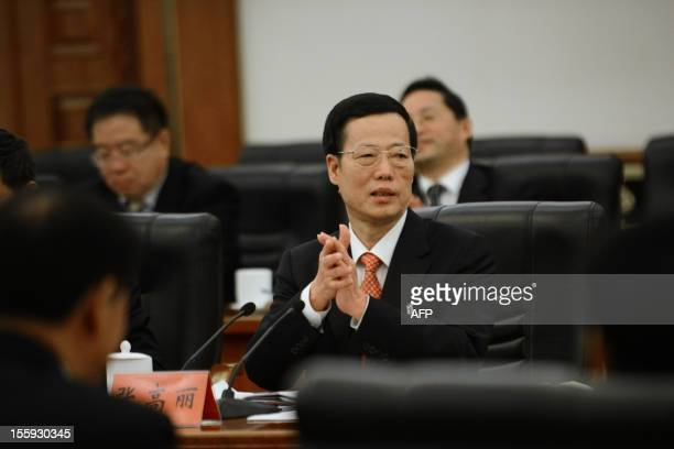 Communist Party Secretary of Tianjin, Zhang Gaoli, applauds after a panel discussion of the Tianjin delegation during the 18th National Congress of...