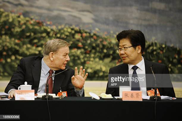 Communist Party Secretary of Xinjiang Uygur Autonomous Region, Zhang Chunxian talks with a delegate during a panel discussion of Xinjiang delegation...