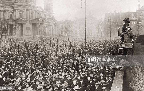A communist speaker addresses a large crowd in Berlin to protest about the unemployment situation in Germany circa 1920