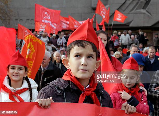 Communist supporters holding red flags take part in a rally to mark the 99th anniversary of Russia's Bolshevik Revolution in Sevastopol Crimea on...