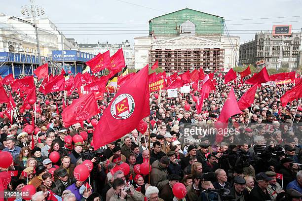 Communist supporters stand with Soviet red flags during the May Day demonstrations on May 1 Moscow Russia Tens of thousands of people across Russia...