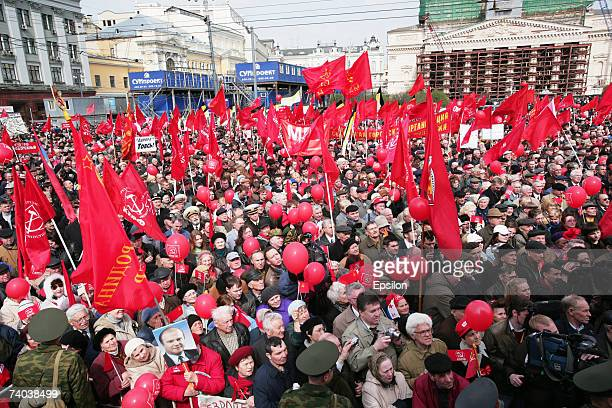 Communist supporters stand with Soviet red flags during the May Day demonstrations on May 1 Moscow RussiaTens of thousands of people across Russia...