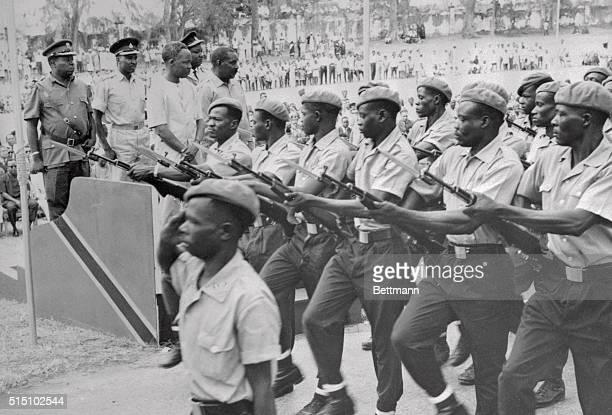 Communist trained Zanzibar soldiers march past the saluting base as Zanzibar celebrated the fourth anniversary of the Amalgamation of Zanzibar and...