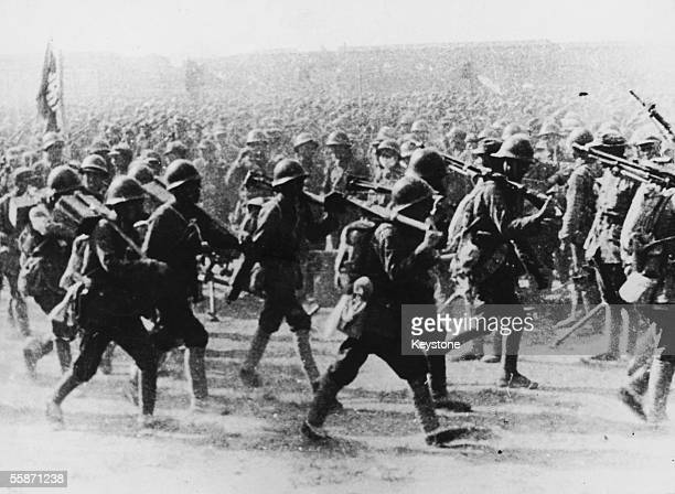 Communist troops marching in China as the Chinese army attempt to gain control of Shanghai during the civil war 21st May 1949