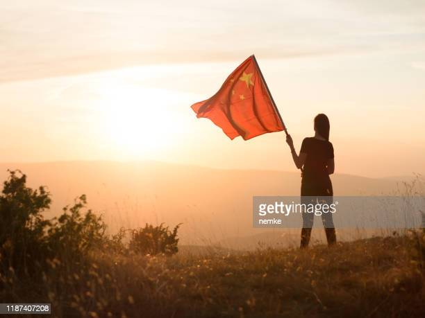communist with chinese flag on top of a mountain - communism stock pictures, royalty-free photos & images