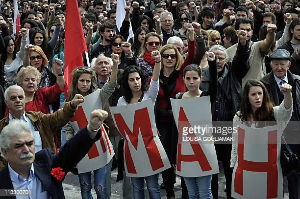 Communistaffiliated demonstrators sing the 'Internacionale' during a rally marking May Day in Athens on May 1 2011 Greek unions marked May Day with...
