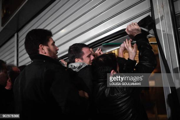 Communistaffiliated PAME workers unionists break into the Ministry of Labour in Athens on January 9 during a protest against a law submited to the...
