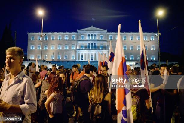 Communistaffiliated workers unions and supporters take part in a rally in front of the Greek parliament in central Athens on September 13 to protest...
