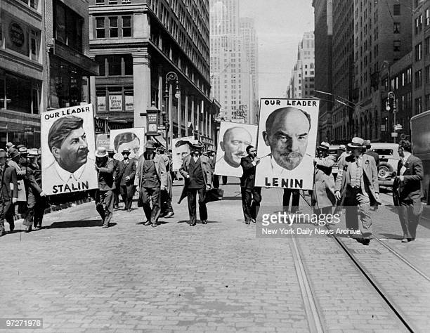Communists carry posters of Russian Communist leaders during May Day parade in New York