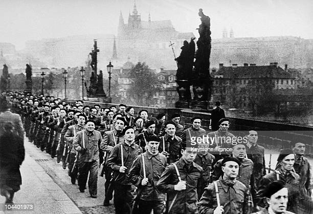 Communists taking power in Czechoslovakia Members of the Czech popular militia crossing the Charles IV bridge In the background can be seen the...
