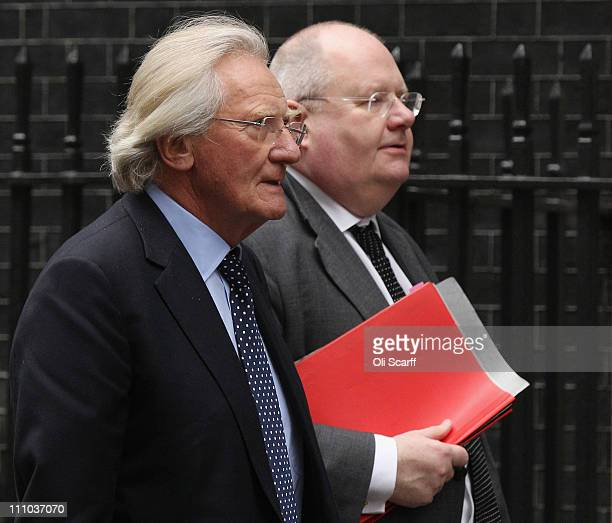 Communities and Local Government Secretary Eric Pickles arrives in Downing Street with Lord Heseltine on March 29 2011 in London England Delegates...
