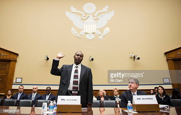 Community activist and whistleblower Frederick Newell takes the oath as his attorney Tom DeVincke watches during to the House Oversight and...