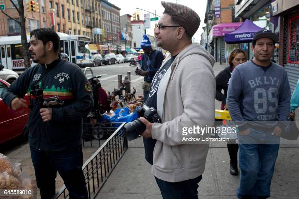 Community activist Dennis Flores patrols his neighborhood documenting police harassment or mistreatment of immigrants and for any ICE raids on...