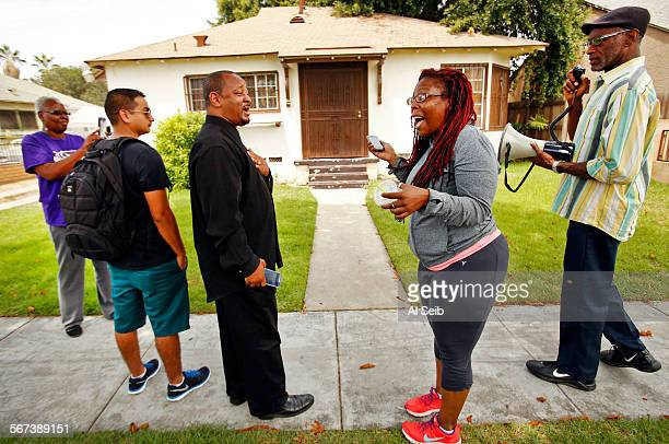 COMPTON CA JULY 28 2014 Community activist Najee Ali center left exchanges words with Jasmyne Cannick center right on Monday July 28 2014 outside the...
