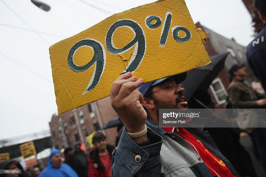 Community activists and over two hundred members of the Occupy Wall Street movement march in the impoverished community of East New York to draw attention to foreclosed homes in the community on December 6, 2011 in the Brooklyn borough of New York City. The group said they would occupy a home and would hand the property over to a homeless family. In what organizers are describing as a 'new frontier' for the movement, thousands of other Occupy Wall street protesters around the country participated in similar actions.