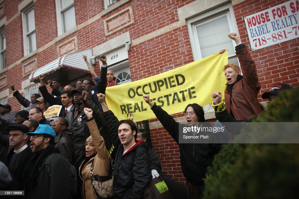 Community activists and over two hundred members of the Occupy Wall Street movement rally around a forclosed home during a march in the impoverished community of East New York to draw attention to foreclosed homes in the community on December 6, 2011 in the Brooklyn borough of New York City. The group said they would occupy a home and would hand the property over to a homeless family. In what organizers are describing as a 'new frontier' for the movement, thousands of other Occupy Wall street protesters around the country participated in similar actions.