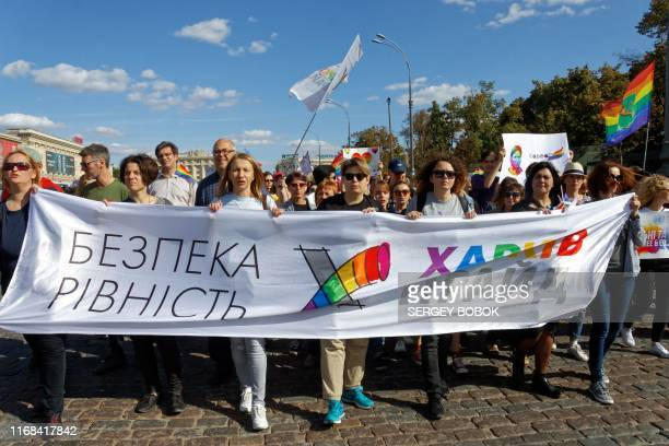 LGBT community activists hold a banner reading Safety and equality during the Kharkiv Pride march in Kharkiv on September 15 2019