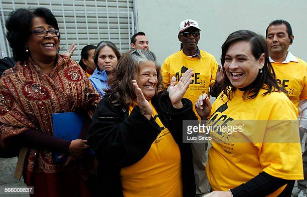 Community activists Maria Gomez center and Martha Sanchez right celebrate with LA City Councilwoman Jan Perry left after winning an eight–year battle...