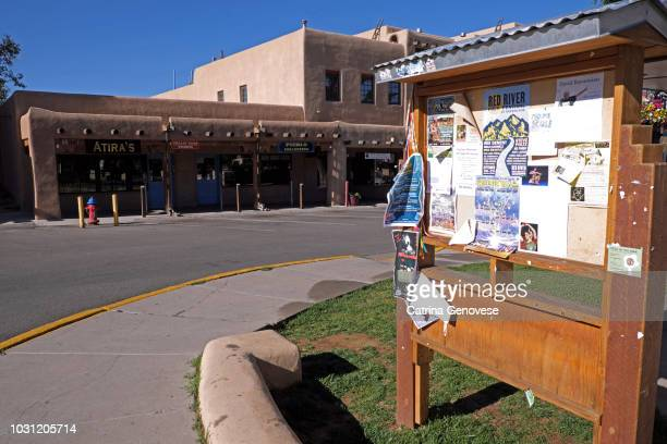 community bulletin board on mccarthy plaza historic district of taos, new mexico - bulletin board flyer stock pictures, royalty-free photos & images