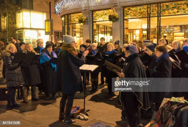 community choir singing at christmas in york - choir stock photos and pictures