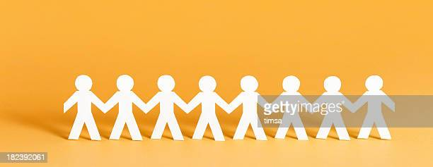 community concept - people in a row stock pictures, royalty-free photos & images