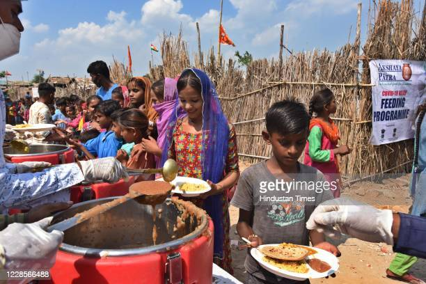 A community feeding session for Hindu refugees from Pakistan on the occasion of Prime Minister Narendra Modis 70th birth anniversary Majlis Park...