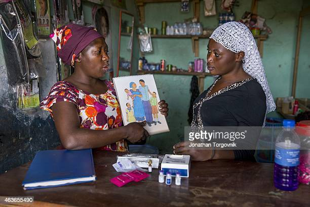 Community health worker during a home visit providing family planning services and options to women in the community This proactive program is...