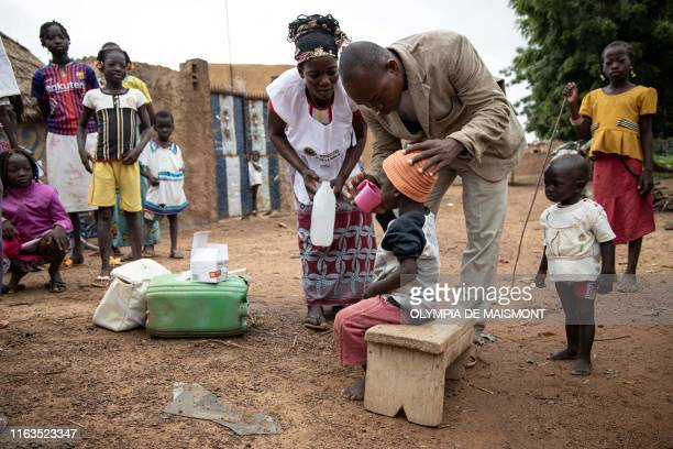 Community health workers give a child Seasonal malaria chemoprevention , in the village of Goundri, in Ziniare, north east of Burkina Faso's capital...