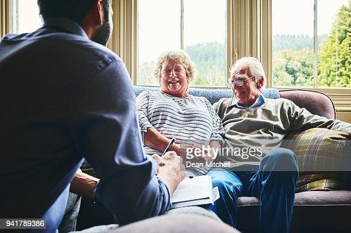 Community healthcare worker visiting senior couple at home