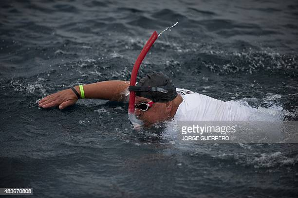 Community leader of the French SaintEtienne branch of international charity association Emmaus Alain Gomez swims during his crossing along with a...