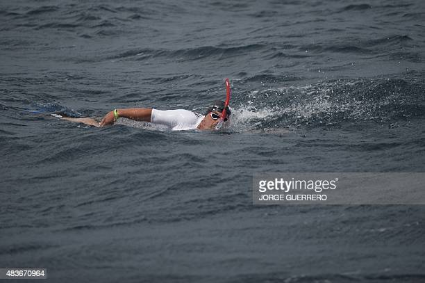 Community leader of the French SaintEtienne branch of international charity association Emmaus Alain Gomez swims during his crossing of the strait of...